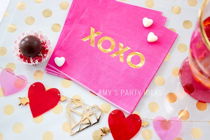 XOXO foil printed valentines napkins | Cupid is Stupid Galentines Girl's Night Valentine's Day Ideas from AmysPartyIdeas.com & #swoozies